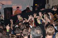 Frank crowd surfs.
